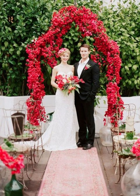 a deep red all-bloom wedding arch with an elegant shape