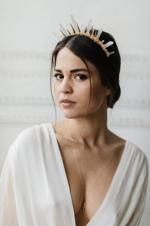 a gold crown with metal spikes and clear crystals looks very chic and refined