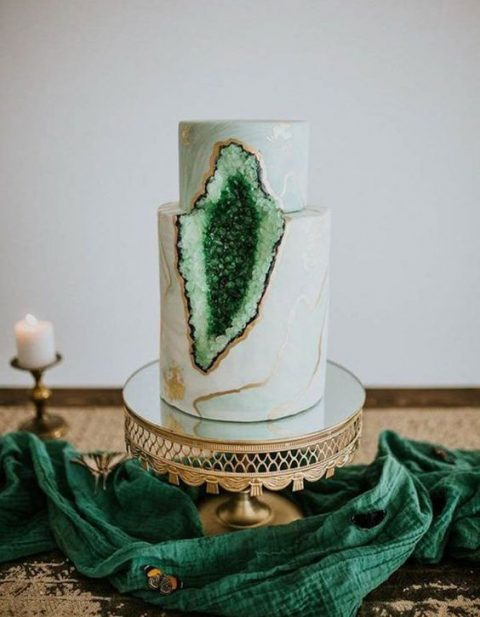 a gorgeous marble wedding cake with copper leaf and emerald geode is a fashionable option