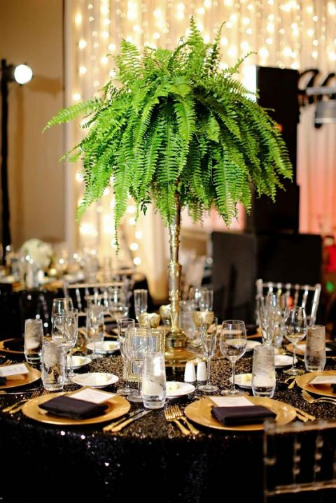 a lush and tall fern wedding centerpiece is great not only for tropical but for glam and art deco weddings, too