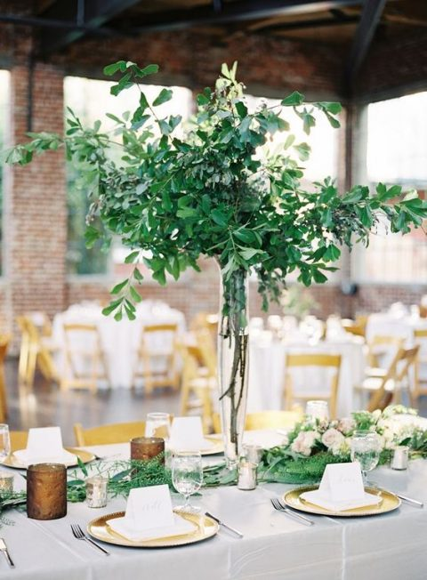 a lush and tall greenery centerpiece of branches and leaves is a very modern idea