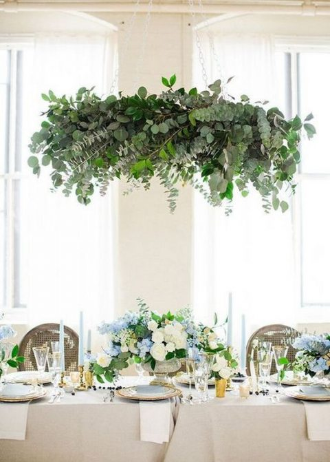 a lush eucalyptus chandelier over the reception space