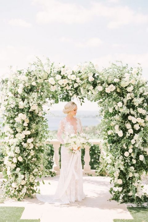 a lush greenery and white bloom wedding arch is timeless classics