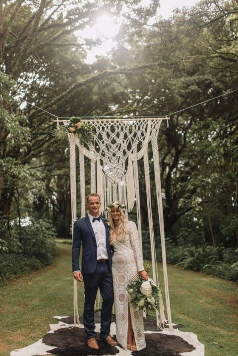 a macrame hanging backdrop looks ethereal and beautiful, add layered rugs