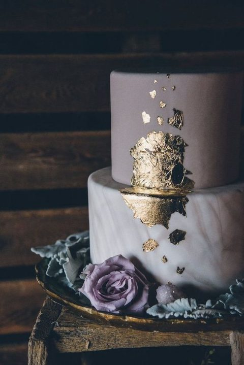 a purple and purple marble wedding cake with gold leaf and purple blooms around