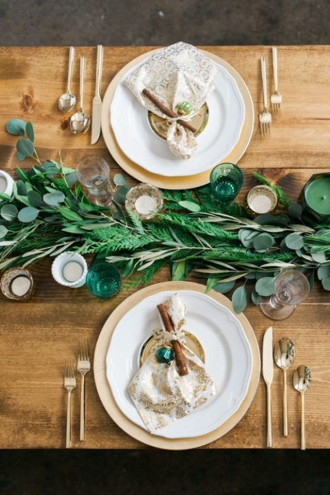 a simple fern and eucalyptus table runner and green and neutral candles
