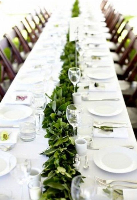 a simple greenery table runner will refresh your neutral tablescape, even if you have an all-white wedding