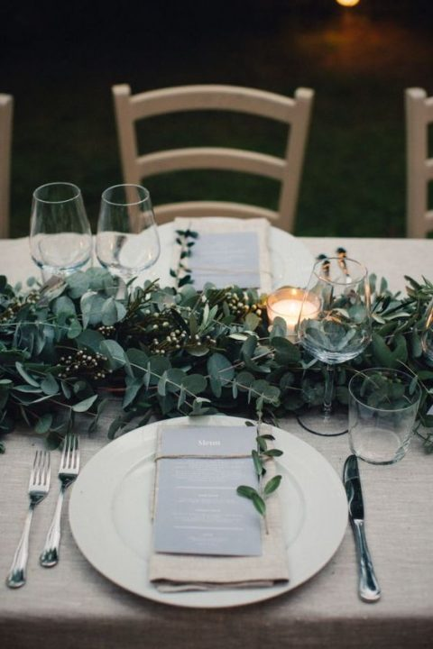 a stylish eucalyptus and fresh berries table runner with candles will refresh your tablescape