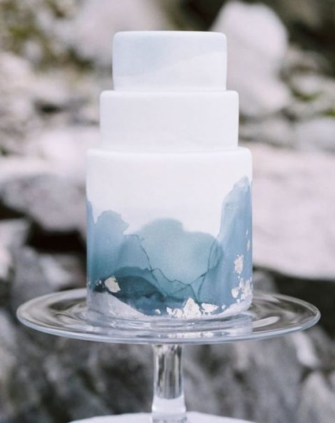 a watercolor blue grey wedding cake is suitable for a modern coastal wedding