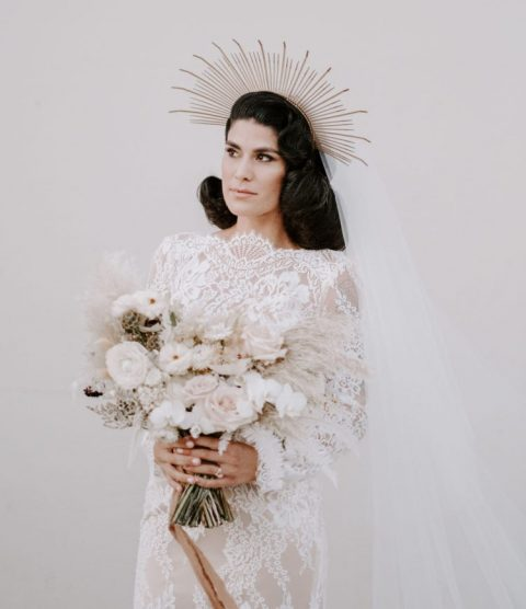 a whimsy sunburst wedding headpiece with a long veil to add a bit of edge to the refined look