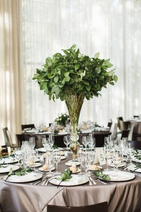 an elegant foliage wedding centerpieces and little green branches for each place setting