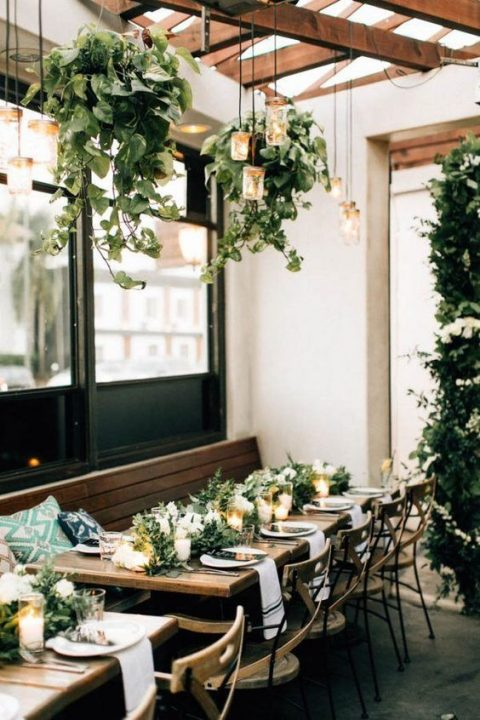 cascading greenery hangings plus some lanterns for a homey feel in your reception
