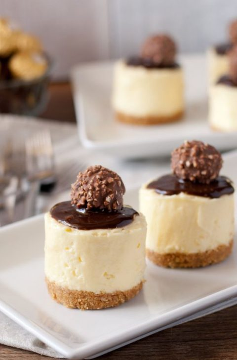 creamy no bake cheesecakes with some chocolate and Ferrero Roche on top