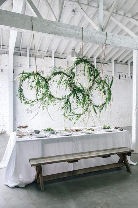 greenery wrapped hoops over the reception table or some bar is a gorgeous decoration