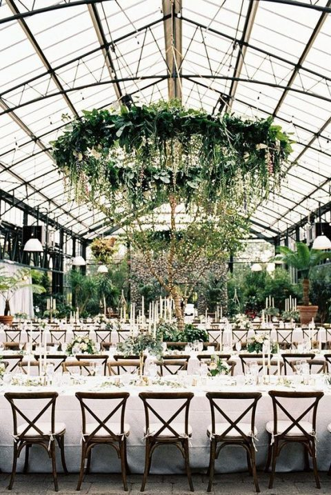 lush and large greenery chandelier with cascading elements for wedding reception decor