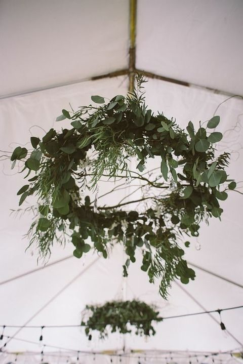 lush and textural greenery chandeliers for reception decor