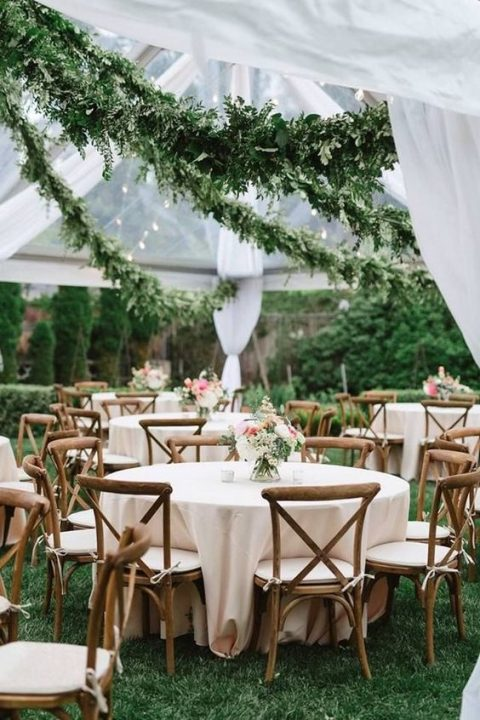 lush greenery garlands over the reception space