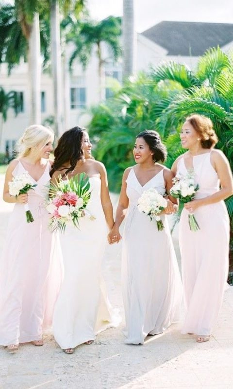 matching blush and white maxi bridesmaid dresses with a catchy neckline