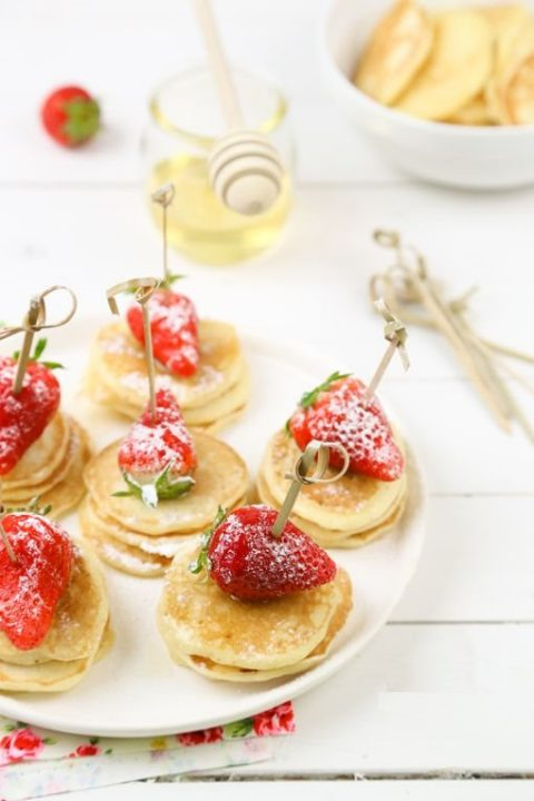 mini pancake skewers with strawberries on top