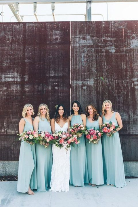 mismatching airy light blue bridesmaid gowns match the tropical vibe