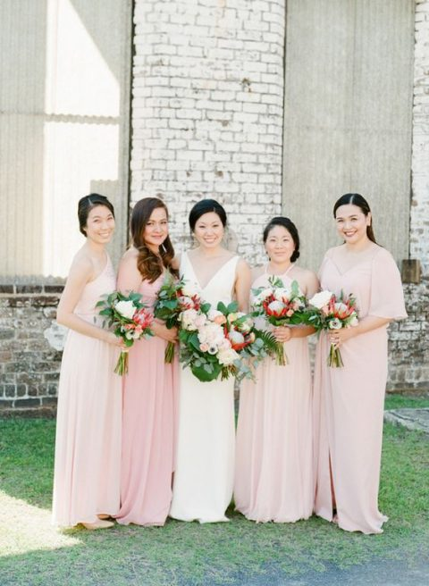 mismatching blush and ivory maxi bridesmaid dresses for a tropical wedding