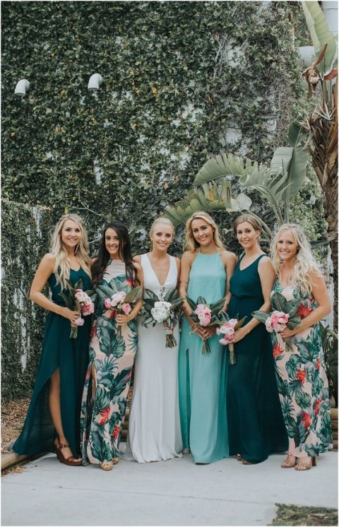 mismatching bridesmaid maxi dresses - with floral prints, in dark green and light blue with different necklines