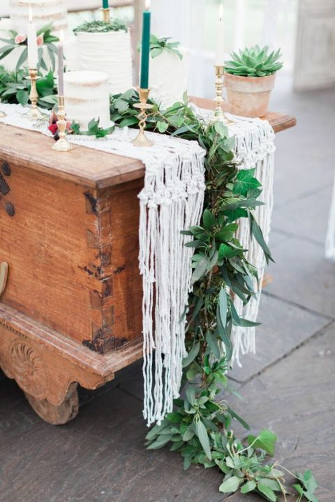 pair a macrame table runner with a lush greenery one with textural foliage