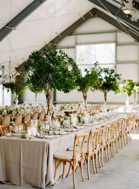 such tall foliage centerpieces remind of real trees and bring an organic feel to the space making it outdoorsy