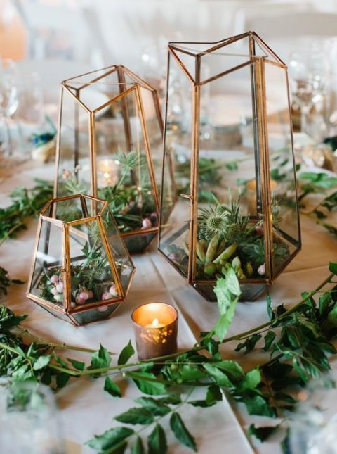 terrariums with greenery, air plants and succulents plus candles and greenery around
