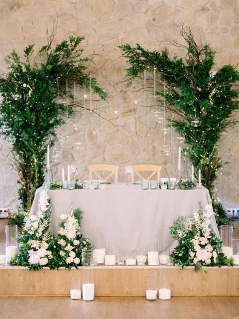 tree-inspired greenery decorations with LEDs to highlight the sweetheart table