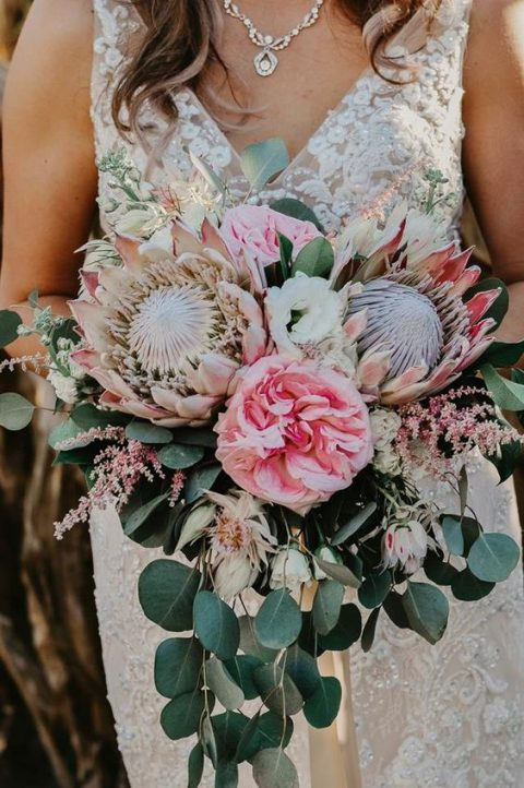 a chic wedding bouquet with pink blooms, king proteas, herbs and eucalyptus