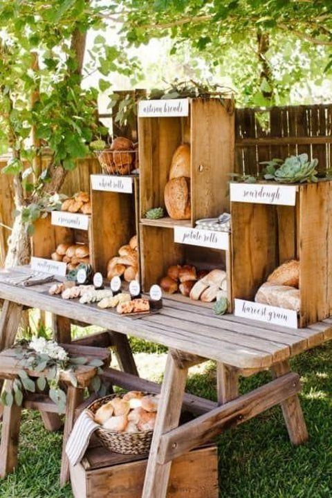 a freesh bread and bun station is a gorgeous idea for many rehearsal dinners, style it with wood boxes and a wood table