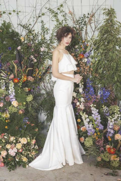 a modern bridal separate with a mermaid skirt and a ruffled crop top