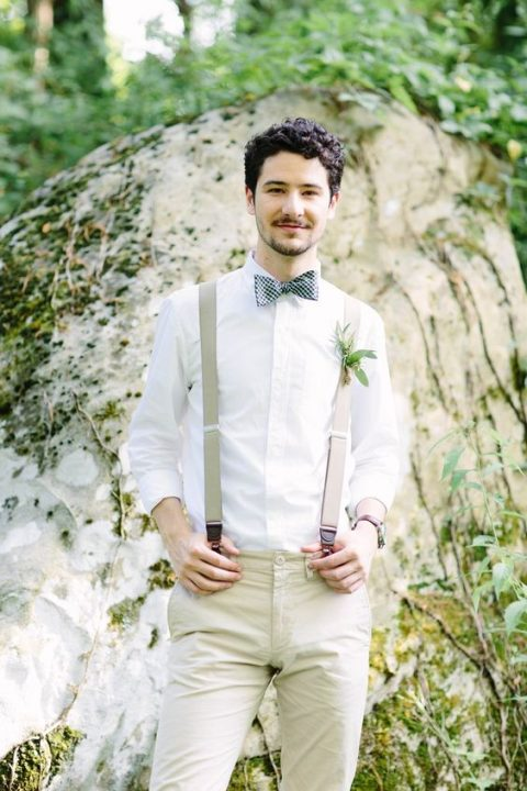 a neutral look with tan pants and suspenders, a checked bow tie and a white button up