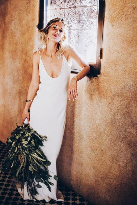 a slip wedding dress with a plunging neckline is a trendy modern option with timeless chic