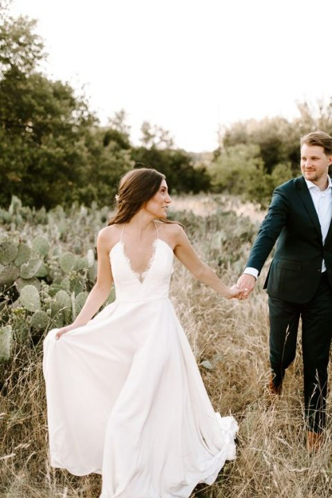 a spaghetti strap wedding gown with a plunging neckline is a unique idea
