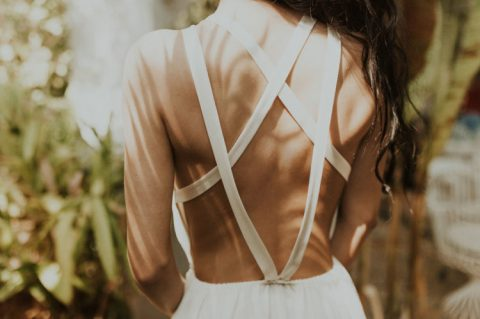 a strappy yet open back and a flowy skirt is a great combo for a hot day
