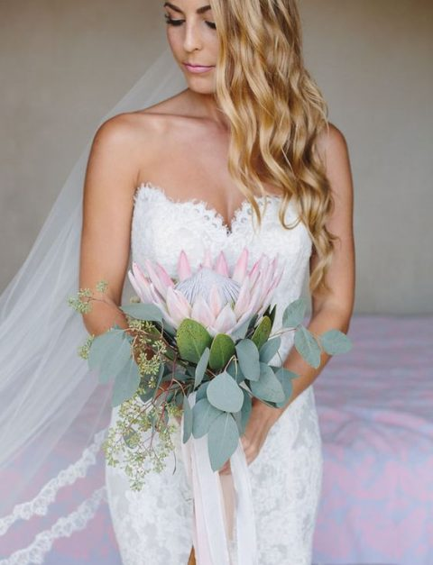 a stylish wedding bouquet with a single king protea and seeded eucalyptus plus blush ribbons
