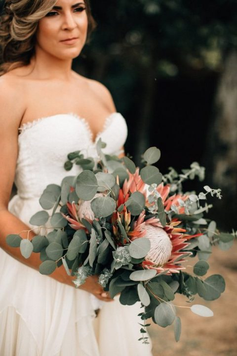 a stylish wedding bouquet with eucalyptus and king proteas
