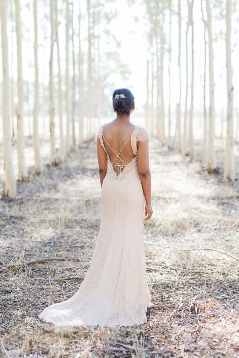 a swoon-worthy wedding dress with a an open back with spaghetti straps