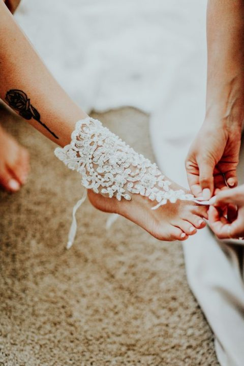 an embellished lace barefoot wedding sandals looks wow