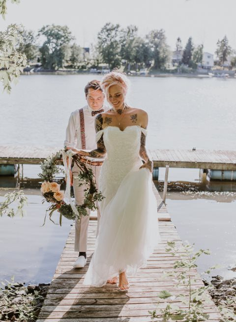 an off the shoulder wedding dress plus walking barefoot will keep you comfortable