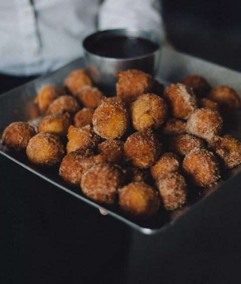 bite-size donut holes with sugary glaze abd a dipping sauce will please everyone