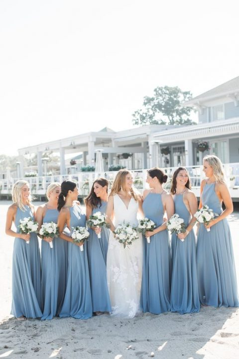 blue halter neckline bridesmaid maxi dresses with pleated skirts