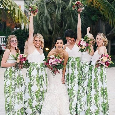 catchy bridesmaid looks with white spaghetti strap tops and tropical leaf print maxi skirts