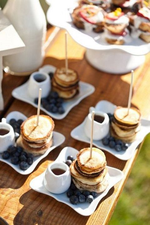mini pancake stacks with blueberries and honey are amazing for those who have a sweet tooth