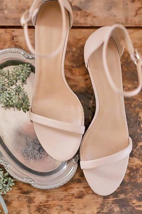 minimalist nude flat wedding sandals with ankle straps are perfect for a hot day wedding