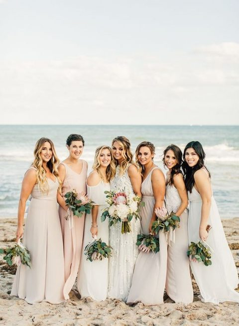 mismatched blush and off-white maxi bridesmaid dresses