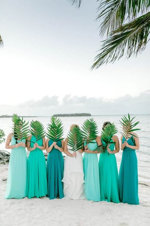 mismatched maxi bridesmaid dresses done in the shdes of sea foam and turquoise and teal