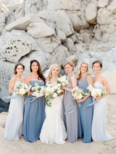 mismatching blue, grey and off-white maxi bridesmaid dresses inspired by the ocean